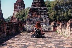 Woman meditating in ancient ruins Stock Image
