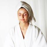 Woman meditating in bathrobe Royalty Free Stock Photo