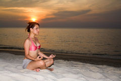 Woman meditating on the beach Royalty Free Stock Photo