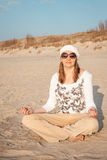 Woman meditating on the beach Royalty Free Stock Photos