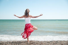 Woman meditating. On beach in lotus position Royalty Free Stock Images