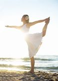 Woman meditating. On beach in lotus position Royalty Free Stock Photos