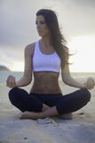 Woman meditating on the beach Royalty Free Stock Images
