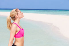 Woman Meditating On Beautiful Beach Stock Images