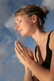 Woman Meditating with Blue Sky Stock Photos