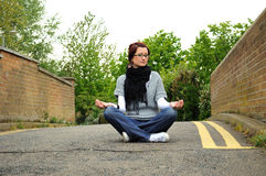 Woman meditating on bridge Royalty Free Stock Photography