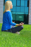 Woman  meditating in City Central Park in yoga lotus pose. Sport, fitness, active lifestyle , urban workout concept Royalty Free Stock Photo
