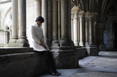 Woman meditating in the cloister Stock Image