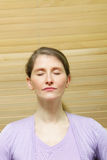 Woman meditating with closed eyes Royalty Free Stock Images