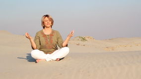 Woman meditating in desert Royalty Free Stock Image