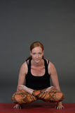 Woman meditating and doing yoga against grey background. Stock Photography
