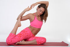 Woman meditating and doing yoga against white background. Stock Photos