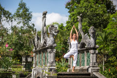 Woman meditating doing yoga. In the park, India Royalty Free Stock Photos
