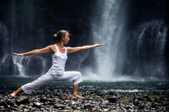 Woman meditating doing yoga Stock Image