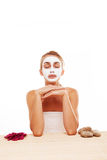 Woman meditating in a face mask Stock Photos