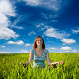 Woman meditating on field Stock Photography