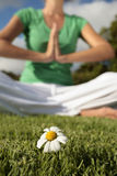 Woman Meditating in a field Royalty Free Stock Photos