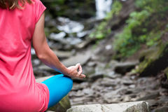 Woman meditating in the forest Royalty Free Stock Images