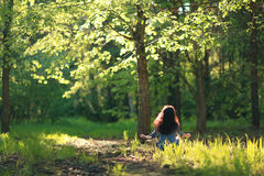 Woman meditating in  forest Royalty Free Stock Images