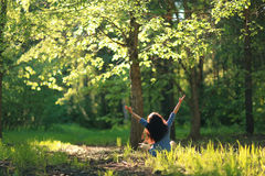 Woman meditating in  forest Stock Images
