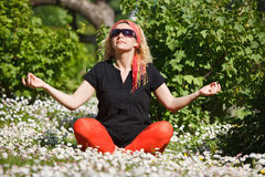 Woman meditating in garden Royalty Free Stock Photos