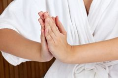 Woman Meditating With Hands Clasped Royalty Free Stock Photos