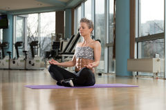 Woman Meditating In A Health Club Doing Yoga Royalty Free Stock Photo