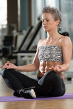 Woman Meditating In A Health Club Doing Yoga Royalty Free Stock Photos