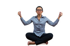 Woman meditating with her legs crossed Royalty Free Stock Photography