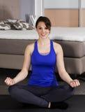 Woman meditating at home Royalty Free Stock Photo
