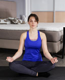 Woman meditating at home Royalty Free Stock Photography