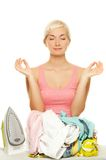 Woman meditating before ironing Stock Image