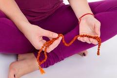 Woman meditating in lotus pose. stock image