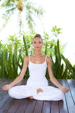 Woman meditating in the lotus position Royalty Free Stock Photo