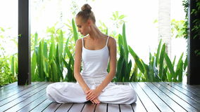 Woman meditating in the lotus position stock footage