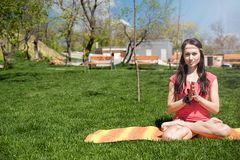 Woman meditating in the lotus position Stock Photography