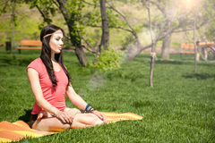 Woman meditating in the lotus position Royalty Free Stock Photography