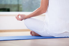 Woman meditating in lotus position Royalty Free Stock Image