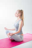 Woman meditating in lotus position Royalty Free Stock Images