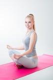 Woman meditating in lotus position Stock Photos