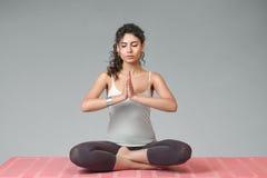 Woman meditating in lotus position Royalty Free Stock Photos