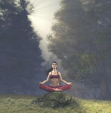 Woman meditating in lotus posture Royalty Free Stock Photography
