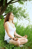 Woman meditating in the lotus Stock Image