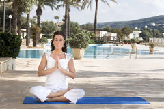 Woman meditating in lotus yoga Royalty Free Stock Image