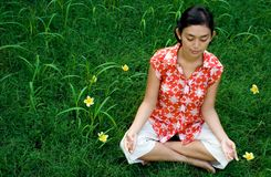 Woman meditating in nature Stock Images