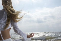 Woman Meditating By The Ocean Royalty Free Stock Photo
