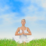 Woman meditating outdoors Stock Images