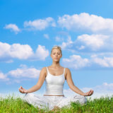 Woman meditating outdoors Stock Photos