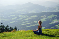 Woman meditating outdoors Royalty Free Stock Images