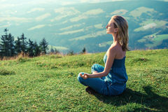 Woman meditating outdoors Royalty Free Stock Image